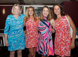 Just a few of the colorful women of 100 Women Who Care Boston North.
