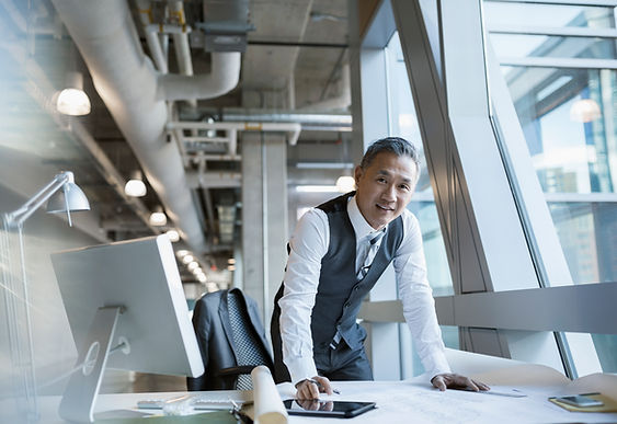 Businessman in downtown office All Seasons Insurance