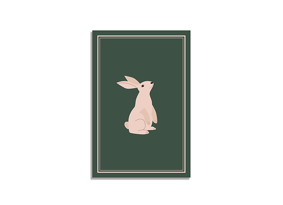 Pink bunny on a green background