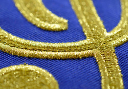 Metallic gold thread treble cleff