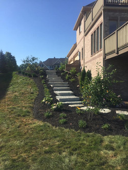 Side wiew of White-to-Gray Stair Stones & landscaping work