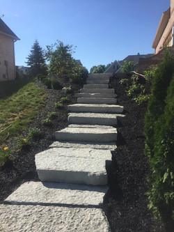Gray-to-White Stair Stones with black mulch and landscaping work
