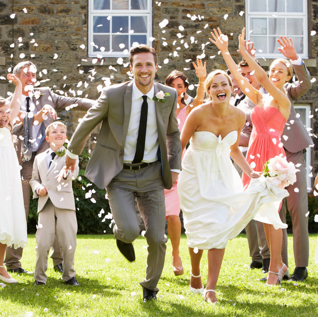 Guests Throwing Confetti Over Bride And