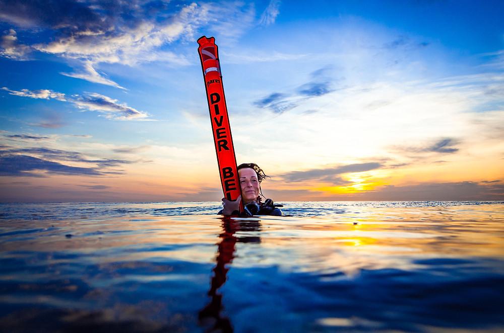 Female Scuba Diver Safety Sausage PADI Open Water