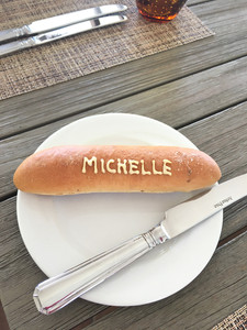 French baguette with the name Michelle written on bread