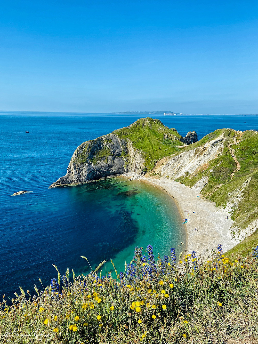 Man Owar Beach at Durdle Door is a curved secluded pebble beach with crystal clear water