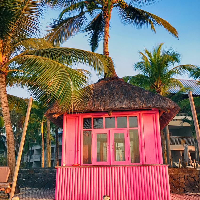 Neon bright pink beach hut Mauritius