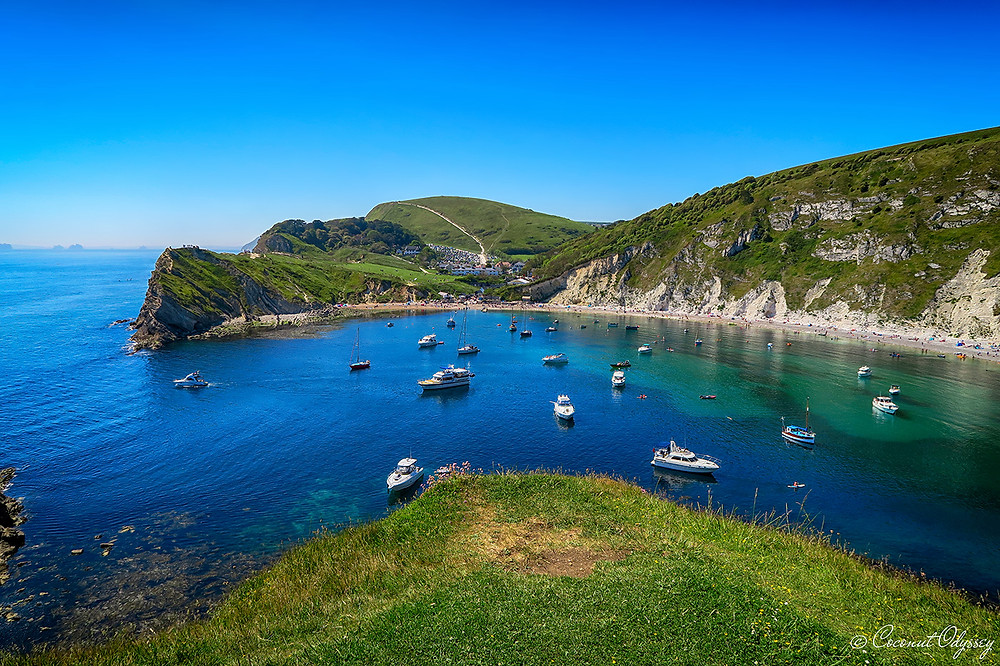 Lulworth Cove, Durdle Door, a stunning horseshoe bay with turquoise water, perfect for paddle boarders.