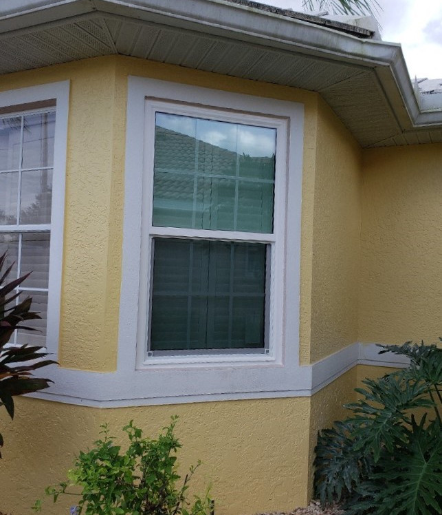 Impact bay windows with colonial grids pgt