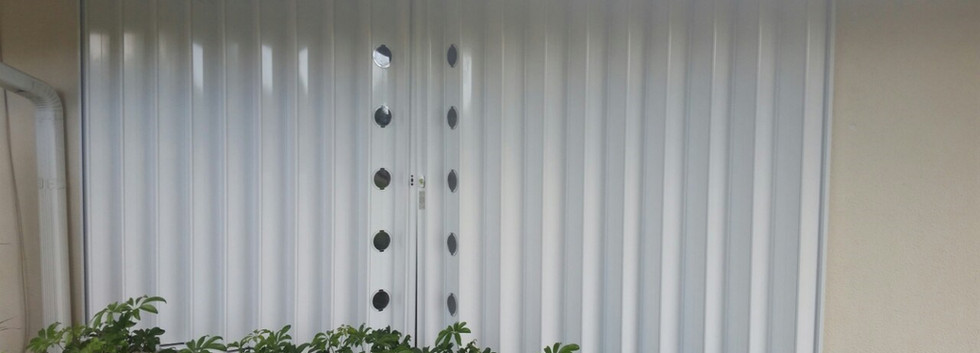 white hurricane accordion shutter florida