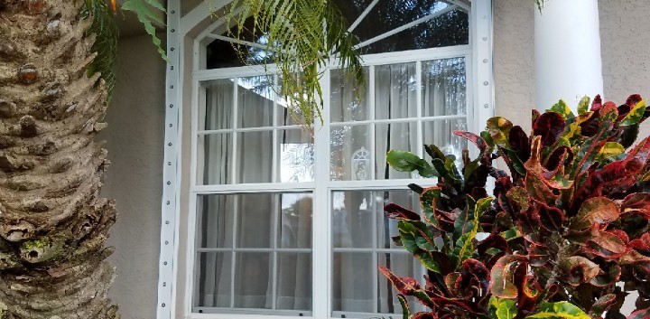 Eyebrown impact pgt window, electric hurricane shutter