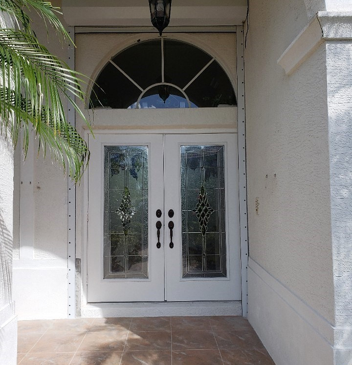 double impact decorative glass transom window with roll down hurricane shutter