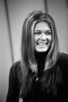 Gloria Steinem at 40 years old, smiling off camera