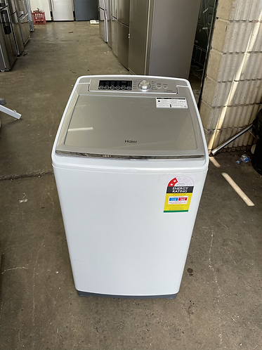 HAIER 7 KG WASHING MACHINE.