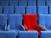 rows with blue chairs and one red standing out.