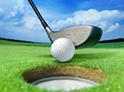 Golf club ready to toss ball in hole