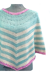 """Pattern """"Noncho"""" knitted with blue white and pink yarn on a grey maniquen that is facing directly at the camera"""