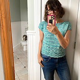 """Mirror selfi of Casapinka wearing the pattern """"The Birdwatcher"""", knitted in aqua spekeled yarn, with Sharon from Security on a toilet in the background"""