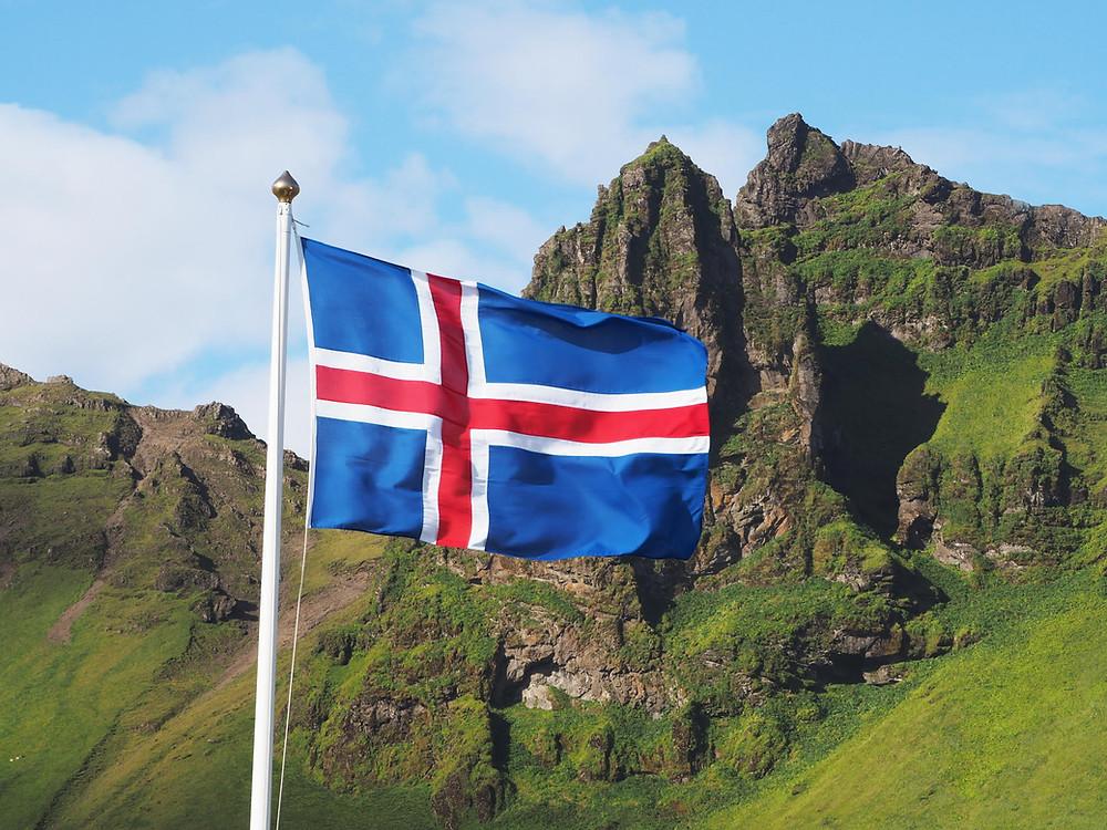 Icelandic flag flying at Thingvellir national park in Iceland. icelandic heritage iceland flag icelandic heritage and culture icelandic history #icelandicroots #icelandhistory #icelandicemigrationhistory #newiceland
