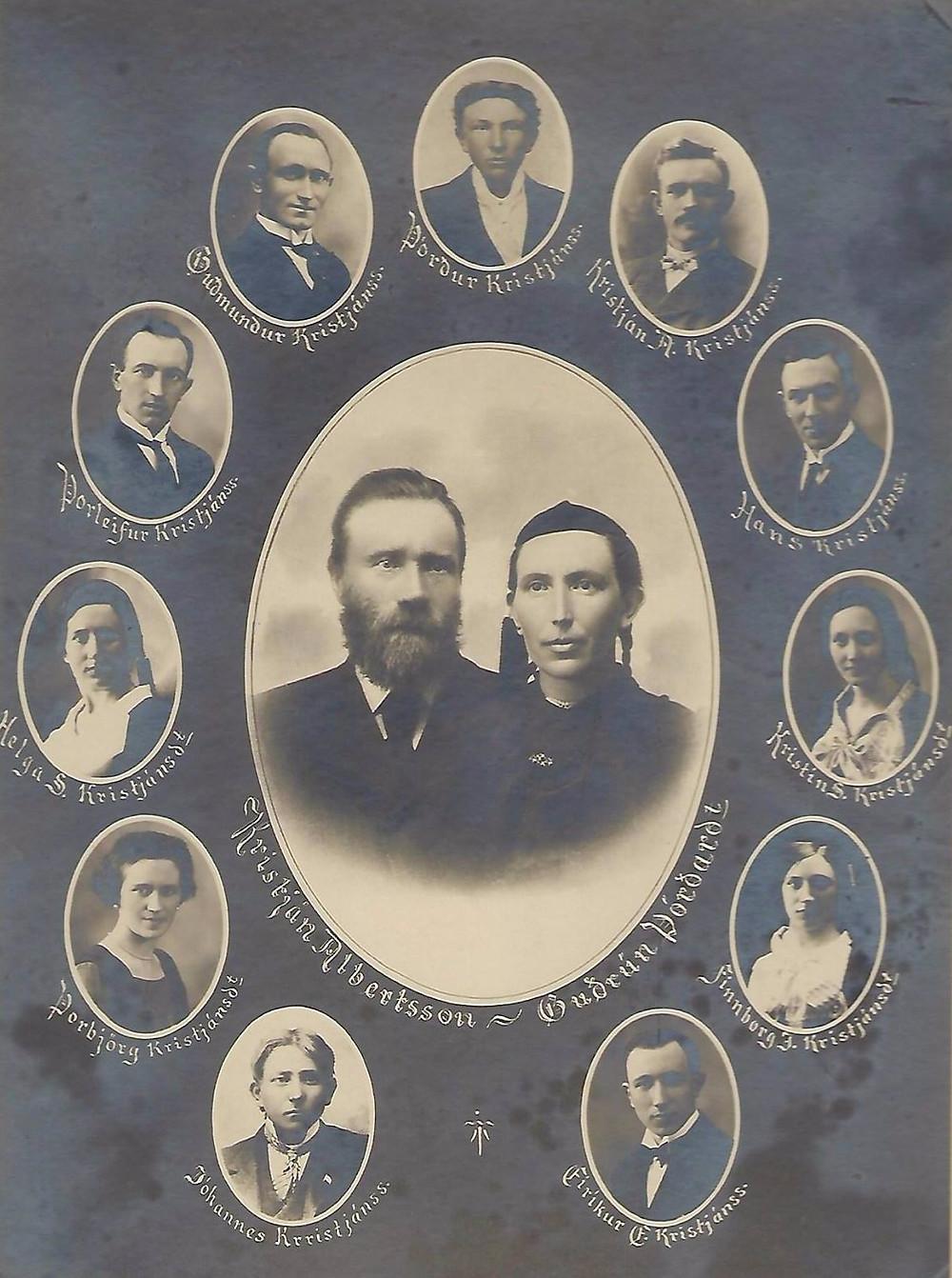 Guðrún Þórðardóttir and her husband Kristján Albertsson surrounded by 11 of their children.