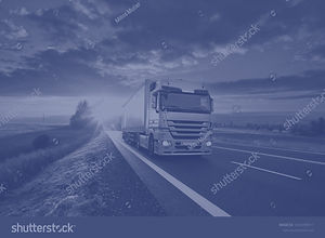 stock-photo-truck-driving-on-the-asphalt
