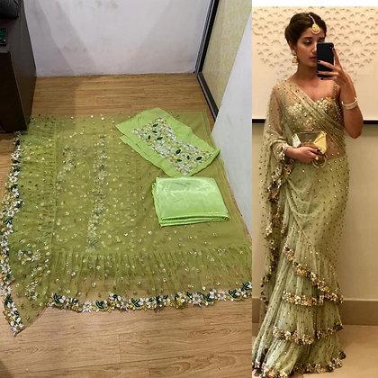 Designer Parrot Green Net Ruffle Border Saree