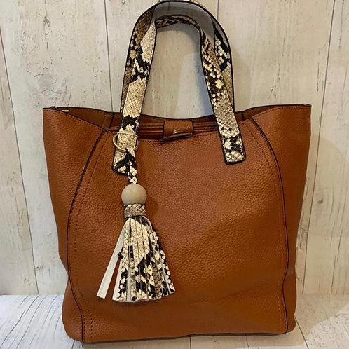 Tan tote bag with snake print handles