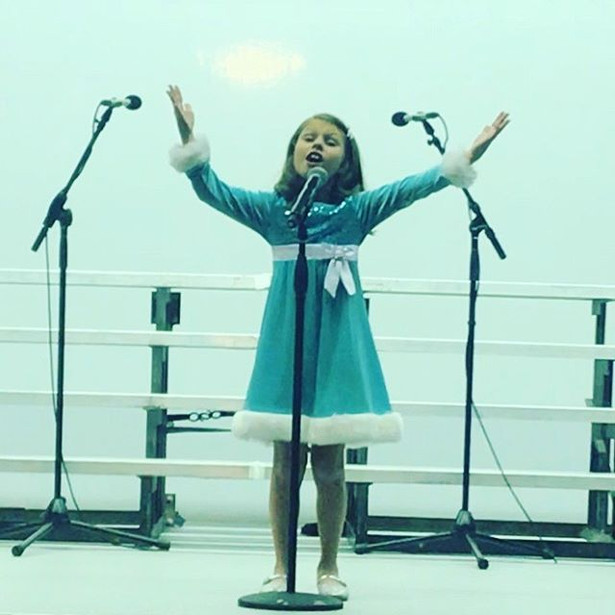 Featured Singer Aria Besse singing at th