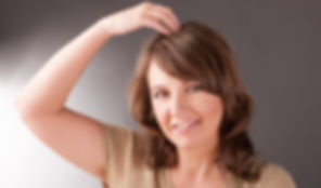 Woman doing EFT on the top head point. E