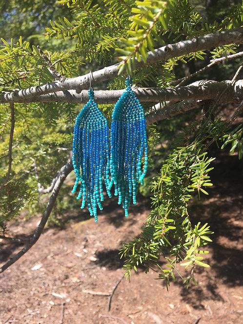 The skies are blue tassel earrings.