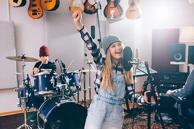 kids playing instruments in music studio.jpg