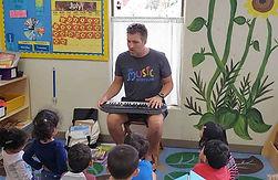 Mr Elias teaching a music lesson