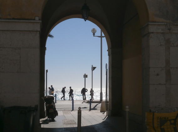 View of ocean through archway in Cours Saleya