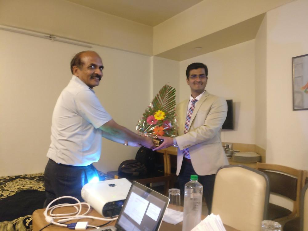 Dr. Mayur Kardile being felicitated by Dr Gunaki, Professor of Orthopedics KIMS Karad)