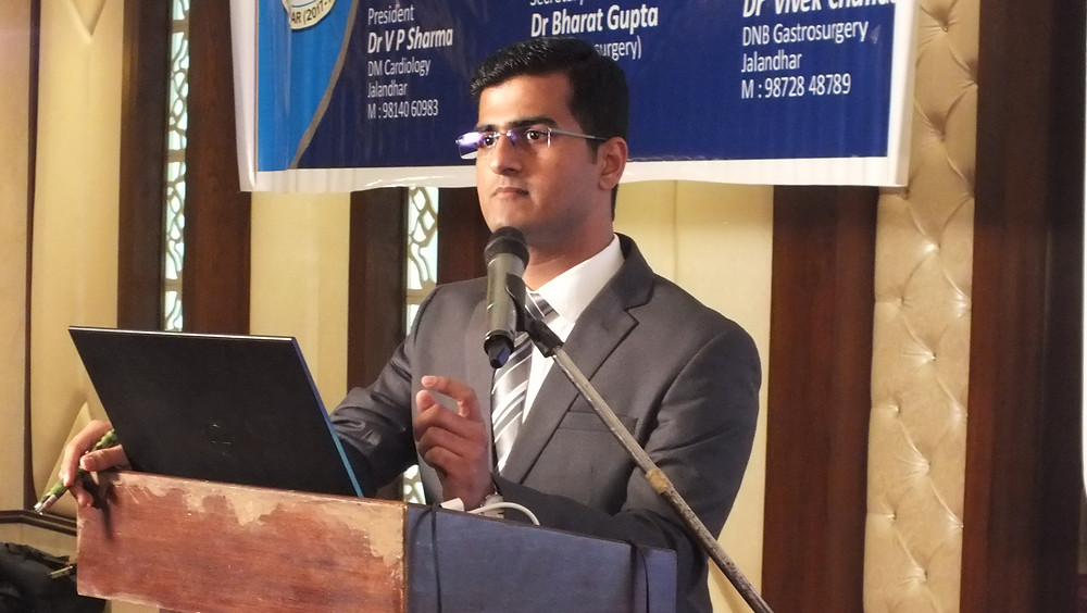 Dr. Mayur Kardile delivering a lecture on Tuberculosis of Spine at CME in Jalandhar