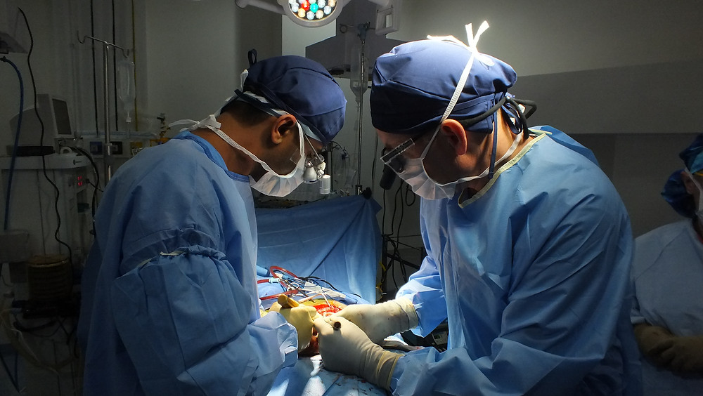 Dr. Mayur Kardile operating on a patient with scoliosis at Standing Straight Spine deformity correction mission in Jalandhar