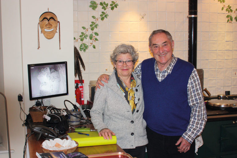 Terry and Jo Mills. The TV shows live footage of their barn owl box.
