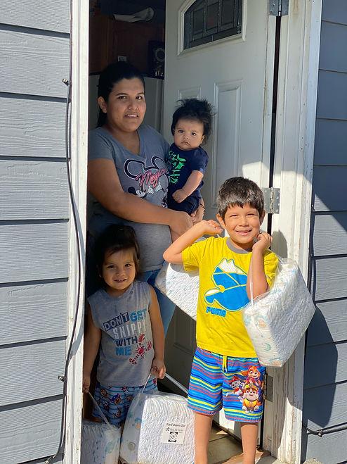 Photo - Maya Martinez with Jose, Ian, an