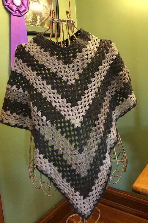 Crocheted poncho, must be special ordered.