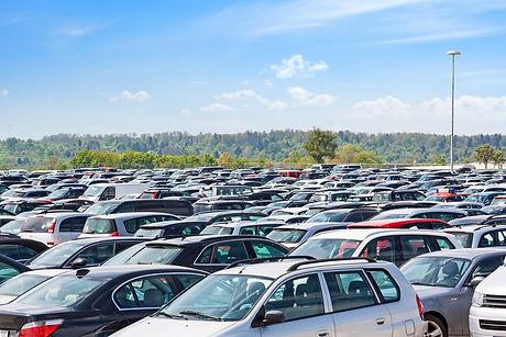 Lots of cars parking at airport carpark.