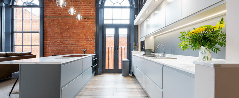 Modern kitchen complete with in-built appliances and hidden drawers.