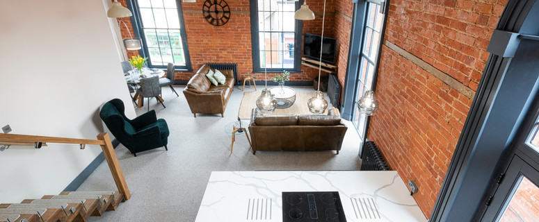 Two stunning mezzanine apartments with 5m high ceilings to the first floor, restored original brickwork giving a cool and modern loft-aesthetic and beautiful 3.5m arched sashed windows.