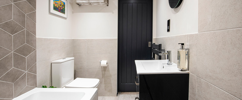 luxuriously fitted bathroom with a bathtub and wet room section with a separate shower
