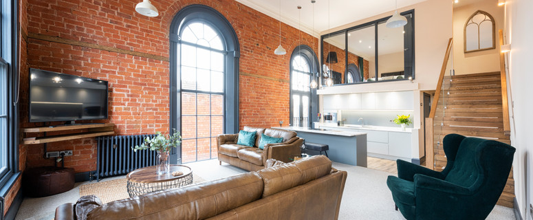 The exposed brickwork and 3.5m high sash windows remind guests of the history of the building which is a former Methodist church, Built in 1848