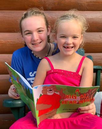 girls reading and smiling.jpg