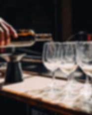 filling-wine-glasses-on-counter_large.jp