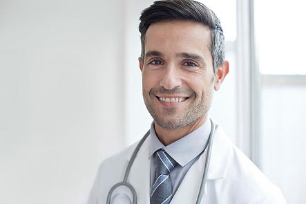 male-doctor-smiling-towards-camera-scien