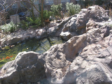 Small artificial rock waterfall