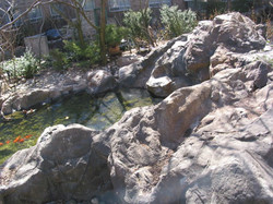 Small artificial rock waterfall