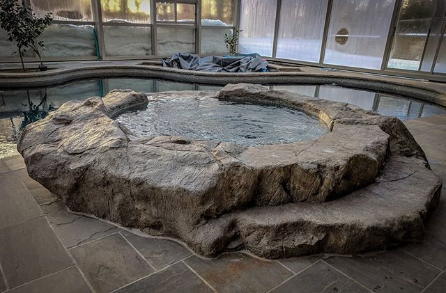 Custom rock spa surround, step and water